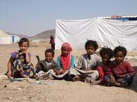 "Yemeni children sit at the Jaw al-Naseem camp for internally displaced people on the outskirts of the northern city of Marib, on February 18, 2021 in the Saudi-backed Yemeni government's last northern bastion. Until early last year, life in Marib city was relatively peaceful despite the Yemen's civil war that erupted in 2014. The United Nations warned last week of a potential humanitarian disaster if the fight for Marib continues, saying it has put ""millions of civilians at risk"". More than 3.3 million have"