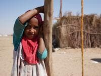"A Yemeni girl stands at the Jaw al-Naseem camp for internally displaced people on the outskirts of the northern city of Marib, on February 18, 2021 in the Saudi-backed Yemeni government's last northern bastion. Until early last year, life in Marib city was relatively peaceful despite the Yemen's civil war that erupted in 2014. The United Nations warned last week of a potential humanitarian disaster if the fight for Marib continues, saying it has put ""millions of civilians at risk"". More than 3.3 million hav"