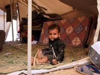 "A Yemeni child sits in a tent at a camp for internally displaced people on the outskirts of the northern city of Marib, on February 18, 2021 in the Saudi-backed Yemeni government's last northern bastion. Until early last year, life in Marib city was relatively peaceful despite the Yemen's civil war that erupted in 2014. The United Nations warned last week of a potential humanitarian disaster if the fight for Marib continues, saying it has put ""millions of civilians at risk"". More than 3.3 million have been"