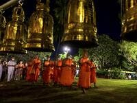 Buddhist monks lead a candlelight procession around Wat Traphang Thong to celebrate Makha Bucha Day in Sukhotai on February 26, 2021. Mladen ANTONOV / AFP