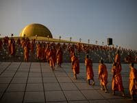 Buddhist monks prepare to take their place ahead of prayers during Makha Bucha celebrations at Wat Dhammakaya, north of Bangkok on February 26, 2021. Jack TAYLOR / AFP