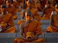 Buddhist monks attend the Makha Bucha celebrations at Wat Dhammakaya, north of Bangkok on February 26, 2021. Jack TAYLOR / AFP