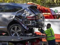 A tow truck operator secures the car that golf legend Tiger Woods was driving when seriously injured in a rollover accident on February 23, 2021 in Rolling Hills Estates, California. (Photo: AFP)