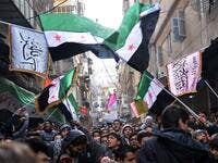 Syrian anti-regime protesters wave pre-Baath Syrian flags
