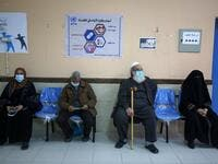 People wait to receive the Sputnik V COVID-19 vaccine at the United Nations Relief and Works Agency for Palestine Refugees (UNRWA) clininc in the Rafah camp for Palestinian refugees in the southern Gaza Strip