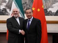 Zarif and Wang Yi: A good handshake