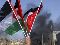 The Palestinian flag rides high