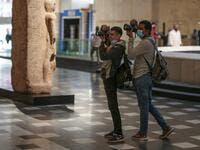 Photojournalists take pictures at Egypt's new National Museum of Egyptian Civilisation