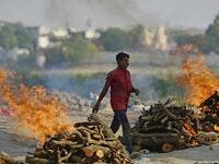 Funeral pyres burn as the last rites are performed of the patients who died of the Covid-19 coronavirus at a cremation ground in Allahabad