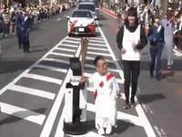 A robot helping to carry the Olympic torch (Image: Tokyo Olympics Twitter)