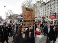 Protesters shout slogans and hold placards during a demonstration on Whitehall opposite Downing Street in central London on Apr. 7, 2018 in support of the Palestianians in the Gaza Strip calling for a stop to the killing organised by the Palestinian Forum in Britain. 