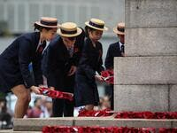 School children lay wreaths during a Remembrance Day ceremony honouring members of the armed forces who died in the line of duty at the Cenotaph marking the 100th anniversary of the end of World War I in Hong Kong on November 11, 2018. 