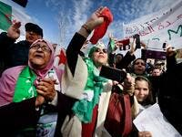 Protesters hold Algerian national flags during a sit-in against the Algerian president's bid for a fifth term in office