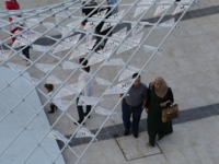Attendees at Amman Design Week walk under a swarm of mechanical butterflies in a project called 'A Path of Synergy,' created by architects and visual artists Rawan Kakish and Hamad al Sultan. (Al Bawaba/Salim Essaid)