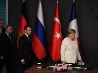 German Chancellor Angela Merkel (R), Russian President Vladimir Putin (2ndL), Turkish President Recep Tayyip Erdogan (L) and French President Emmanuel Macron (C), arrive for a conference during a summit on Syria. (OZAN KOSE / AFP)