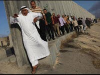 palestinians queue at israeli checkpoint