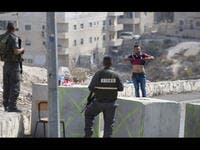 israeli checkpoint with palestinian man