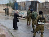 israeli soldiers check woman's ID