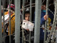 palestinian children barbed wire checkpoint