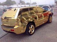 Gold SUV (eshowbizbuzz)