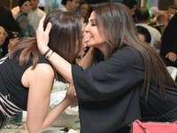 Elissa greeted Egyptian star Angham who sat on the other side of the table