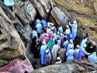 People entering the holy Cave of Hira. (Twitter)