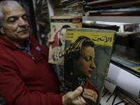 Abboudi Abu Jawdeh shows part of his vintage Lebanese cinema specialised magazines collection at his office in the Lebanese capital Beirut  JOSEPH EID / AFP