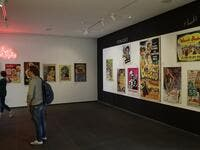Visitors observe vintage cinema posters displayed at an art exhibition in the Lebanese capital Beirut  JOSEPH EID / AFP