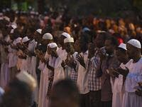 Supporters of Sudanese Islamist movements perform the Maghrib (sunset) prayer ahead of Iftar (AFP)