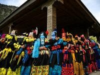 In this picture Kalash women wearing traditional dresses dance to celebrate 'Joshi', a festival to welcome the arrival of spring, at Bumburate village in the mountainous valleys in northern Pakistan. AAMIR QURESHI / AFP