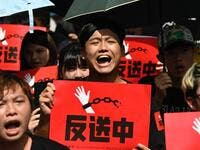Protesters display placards during a demonstration in Taipei  (AFP)