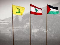 The flags of Lebanon's Hezbollah resistance movement (L), Lebanon (C), and Palestine flying near the southern Lebanese village of Kfar Kila /AFP
