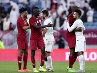 Qatar's players shake hands and embrace with Saudi's after the 24th Arabian Gulf Cup semi-final football match between Saudi Arabia and Qatar at al-Janoub Stadium in the Qatari capital Doha