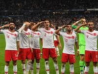 Turkish players salute at the end of the Euro 2020 Group H qualification football match between France and Turkey at the Stade de France in Saint-Denis, outside Paris on Oct 14, 2019.