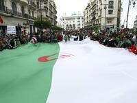 Algerians wave a giant national flag during an anti government demonstration in the capital Algiers, on April 19, 2019. (AFP/ File Photo)