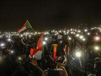 Sudanese protesters open their smartphones lights during a protest outside the army headquarters in the capital Khartoum on April 21, 2019. (AFP/ File Photo)