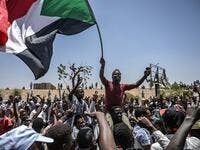 Sudanese protesters shout slogans and wave national flags during a protest outside the army headquarters in the capital Khartoum on April 22, 2019. (AFP/ File)