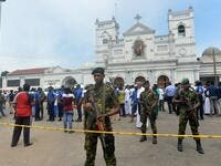 Sri Lankan security personnel keep watch outside the church premises following a blast at the St. Anthony's Shrine in Kochchikade, Colombo on April 21, 2019. (ISHARA S. KODIKARA / AFP)