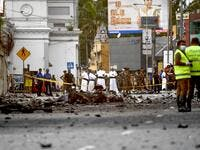 Sri Lankan priests look at the debris of a car after it explodes when police tried to defuse a bomb near St. Anthony's Shrine in Colombo on April 22, 2019. (AFP/ File)