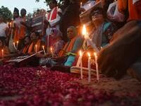 Pakistani civil society activists hold placards and candles to pay tribute to the Sri Lankan blasts victims, during a vigil in Lahore on April 23, 2019. (AFP/ File)