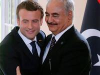 President Emmanuel Macron and Field Marshal Khalifa Haftar, together in 2017. (Jacques Demarthon / AFP)