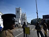 Security personnel stand guard outside St. Anthony's Shrine in Colombo on April 22, 2019, a day after the church was hit in series of bomb blasts targeting churches and luxury hotels in Sri Lanka.  Jewel SAMAD / AFP