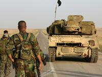 Syrian soldier walk behind a military vehicle (AFP/File Photo)