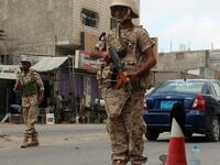 Loyalist forces stand guard on a main road in Al Mansoura district. (AFP/ File)