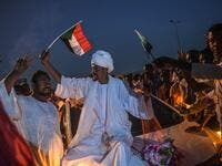 A Sudanese bridegroom waves a Sudan national flag on a wedding car during a protest outside the army complex in the capital Khartoum on April 20, 2019. (AFP)