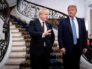 US President Donald Trump (R) and Britain's Prime Minister Boris Johnson speak before a working breakfast at the G7 Summit in Biarritz, France on August 25, 2019. (AFP/ File Photo)