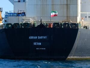 Iranian flag flutters on board the Adrian Darya oil tanker (AFP)