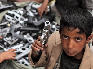 Children playing with toy guns on the street of Sanaa  (Shutterstock)
