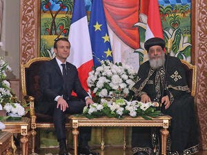 Egypt's Coptic Orthodox Pope Tawadros II (R) meets with French President Emmanuel Macron at the Coptic Church headquarters in Cairo on January 29, 2019. (Ludovic MARIN / AFP)