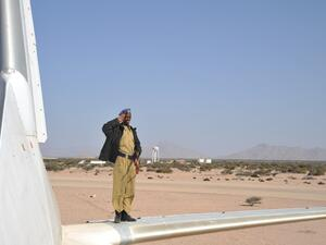 The police officer by crashed plane at the airport of Berbera. (Shutterstock/ File Photo)
